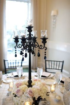 candelabra with flowers at base of design is what I have envisioned for your reception.