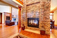 Beautiful stone wall with built-in fake fireplace  Two vases..