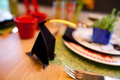 ***Our DIY portion of the table design: - Origami Crow (directions from the internet) including a post-it note in the bird's mouth ready to write the guest's name on. - Origami Vase/Bowl with Sedum from the yard (directions from the internet) - Placemats 'Grass' Paper from Michaels Unique Settings, Table Settings, Eating Well, Crow, Earthy, Decorative Items, Origami, Grass, Vibrant