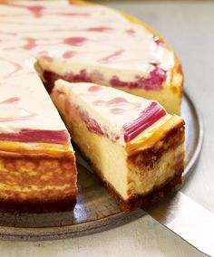 Beautiful baked orange cheesecake with a roasted rhubarb topping.