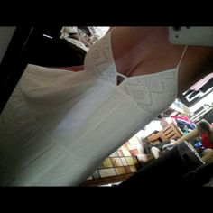 White maxi dress Lomg white maxi dress never been worn with tags. Purchased from tillys size Medium.  Cute crochet detail on bust and tassel ties on the back of dress. Double.lined on inside so its not sheer. I was inlove with it but my boobs were too big so girls with C cups or smaller best fit let them eat cake Dresses Maxi
