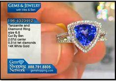A brilliant blue tanzanite trillion cut stone set in a band of diamonds creates a marvelous ring.