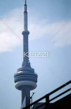 low angle view of the cn tower in toronto canada - Low angle view of a tall spire building against sky.