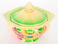 Clarice Cliff - Pink Pearls - A covered sugar box circa 1937, hand painted with a stylised tree landscape in tonal pink and green with graduated green banding,