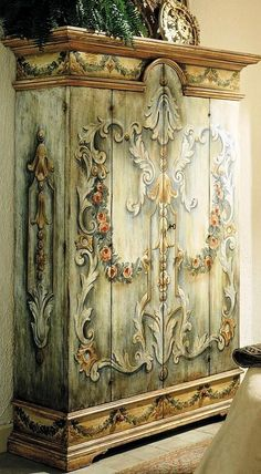 LOVE the paint job on this fabulous armoire!   ~~  Houston Foodlovers Book Club