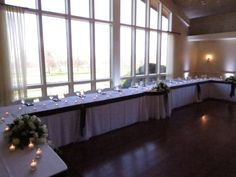 uplighting in white to accent a beautiful head table at lindsey and tommys wedding reception at beautiful color table uplighting