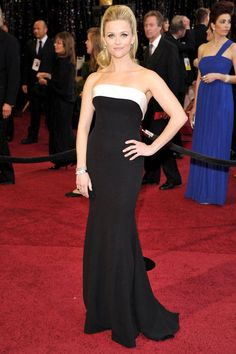Reese Witherspoon in Armani Prive Couture and $1 million worth of Neil Lane diamond and emerald jewellery, at the Oscars in 2011.