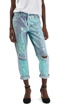 Iridescent sequined chiffon lights up the destructed front of relaxed, cropped jeans calling for concerts and other midnight adventures.