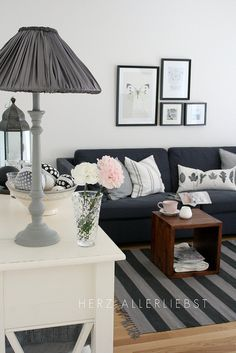 Love the simplicity of this. Need to figure out what to do with our dark gray couch. My heart wanted a crisp, clean white, but my head told me that our 45-lb. dog would ruin all chances of its survival. (At least the charcoal gray will be perfect for a man cave couch when we eventually purchase a house!)