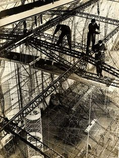 Workers of the Zeppelin factory engaged in building the German airship LZ 129 Hindenburg at great height, 1934.