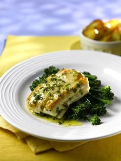 Pan-fried Hake with Lemon Butter Sauce | 4 x 175g hake fillets, skin on and boned 1 tablesp. olive oil 50g butter 1 tablesp. chopped mixed herbs (parsley, chives and tarragon) ½ lemon, pips removed Salt and freshly ground pepper