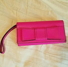 Kate Spade Mara Wristlet Bifold wallet with wrist strap. Gently used and in excellent condition minus one spot of wear which is shown in the 4th photo. Smoke free home. No Trades. Feel free to make an offer!! kate spade Bags Clutches & Wristlets