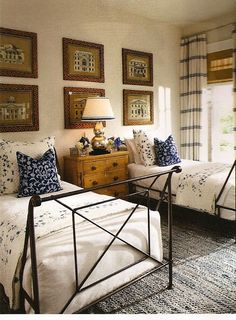 Set of six prints spanning across both beds. Great for guest bedroom.