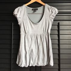 "Shimmery Bubble Top Cute gray shimmery top with a bubble type hem. . Scoop neck baby doll with bubble cap sleeves. INC Brand, Medium, Approx. 15"" armpit/armpit, 23"" length. Material Rayon, Nylon, Metallic. No stains. * small snag at waste band (see pic 4). No other issues. Really cute with long shorts & heels. INC International Concepts Tops Tees - Short Sleeve"