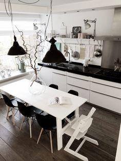 dark floors, white table, black eames chairs, black pendant lamps, white tripp trapp high chair... love it all!
