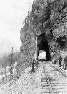 Photograph of a railway tunnel  in British Columbia that passes right through the rock
