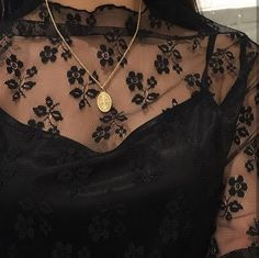 Black floral lace blouse.   I love the neckline detail on this, I'll pair this with a denim mini skirt and black ankle boots for a great day to nighttime look.