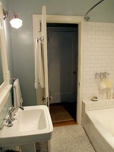 Love the white subway tile and octagon cararra marble floor tiles