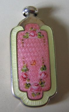 Silver perfume flask with gilded edges and cap Beautiful green guilloche enamel around the outer rim~Gorgeous pink guilloche enamel with a floral swag at the top and bottom