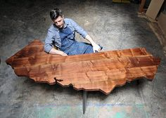 The California Desk: This desk, carefully cut into the iconic shape of California is crafted from native, salvaged Claro Walnut. (this pin brought to you by http://www.erikbishoff.com)