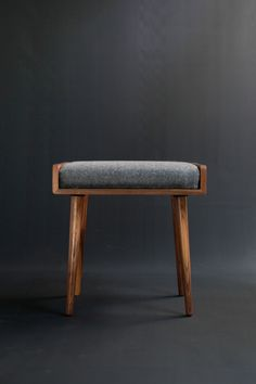 Stool / Ottoman / bench made in solid walnut board, finished in natural oil Upholstered in gray Cold wool.  Dimensions  - 18,9 wide x 13.7 deep x 17.7 high (48 cm wide x 35 cm deep x 45 cm high)