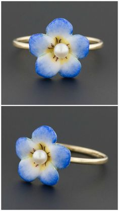 A ring made from a converted antique pin. The flower is blue enamel, with a pearl center.