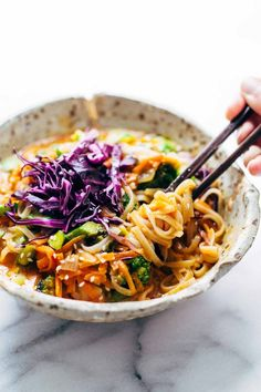 These Bangkok Coconut Curry Noodle Bowls with brown rice noodles are healthy and easy - can be made vegetarian, vegan, or gluten free! #bowl #coconut #curry #noodles #vegetarian | pinchofyum.com