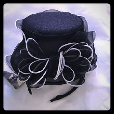 Black Fascinater hat with gray trim and bow This cute little hat is new and has never been worn.  No flaws.   Black with gray trim and bow in front. Something Special Accessories Hats