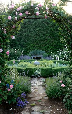garden with rose covered arch at entrance | garden design + photography
