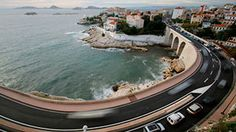 Stock Footage|long exposure time-lapse shot of traffic on the bend in the corniche road, marseilles |Download using the VidLib app. 50.000 Royalty Free Clips