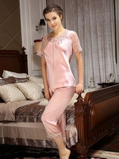 Soft and relaxing, the short sleeves silk pajamas are made of Mulberry silk with a beautiful lace trim at the modern neckline and cuffs. The cropped length pants have an elastic waist with lace edges. Sleepwear Women, Sleepwear & Loungewear, Nightwear, Pyjama Satin, Satin Pajamas, Pyjamas, Silk Pj Set, Mulberry Silk, Lingerie Collection