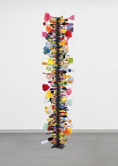 David Batchelor's Parapillar 7 (Multicolour) 2006  Steel support with plastic, metal, rubber, painted wood and feather objects  267 x 78 x 78 cm