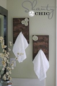 Make your own towel racks.....I'm thinking pallets again.