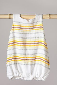 Onesie sunsuit. This is oh so sweet. I can just picture the fat little rolley leg poking out the bottom. :)