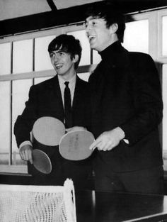 John and George playing ping pong.