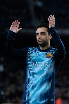 Xavi Hernandez of FC Barcelona acknowledges FC Barcelona supporters as he celebrates his 700th match with the club during the La Liga match between FC Barcelona and Malaga CF at Camp Nou on January 26, 2014 in Barcelona, Catalonia.