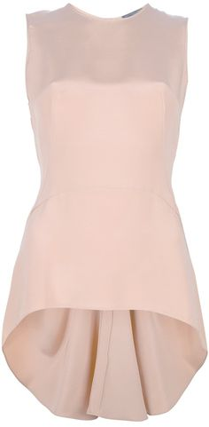 Alexander McQueen ruffled hem blouse: Nude silk sleeveless blouse from Alexander McQueen featuring a round neck, a zip fastening at the rear, a fitted waist, a raised hem at the front and a a dropped ruffled hem at the rear.