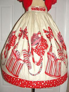 vibrant red and pink hat and hatbox print on 1950s circle skirt.