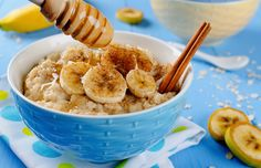 Oatmeal with banana, honey and cinnamon. Breakfast on a blue background
