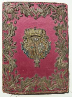 Silver embroidered binding for 1757 opera book - impaled arms