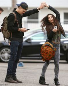 Pay me some attention! Vanessa Hudgens did her best to distract her boyfriend Austin Butler from his mobile phone as the pair stepped out in Venice, California, on Wednesday