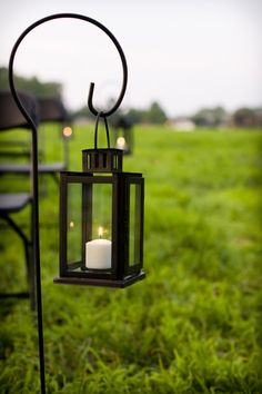 "Use Lanterns to ""light"" your way instead of flower arrangements...you can find these particular   lanterns at Ikea for 5$."