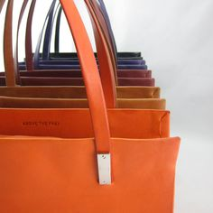 Collect a rainbow's worth of leather totes.