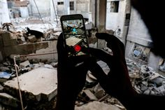 A Syrian gamer uses the Pokémon Go app on his mobile phone to catch a Squirtle amid the rubble in the besieged, rebel-controlled town of Douma, a flashpoint east of the capital Damascus, on July 23. Sameer Al-doumy / AFP / Getty Images