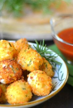 Fried Rosemary Mozzarella Balls --- it's all about molten cheese, a crispy crust, and a tangy tomato sauce for dunking...