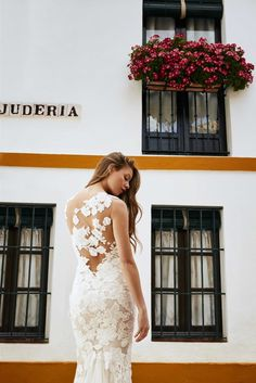 RAEN dressfrom the Atelier Pronovias 2018 Preview Collection. Photographed in Seville, Spain by Dario Aranyo