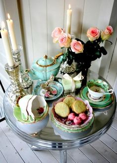 *afternoon tea with candles and flowers*
