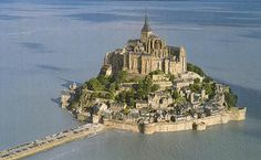 Mont St Michel on the Atlantic Coast of France. Tides cover the access road when the tides come in.  wonderful place to visit, just get out before the tides come!!!!!'   :)