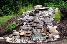 Pondless waterfall with excess dirt from inground trampoline.