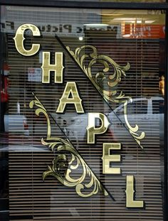 Beautiful signage - gold gilding on glass